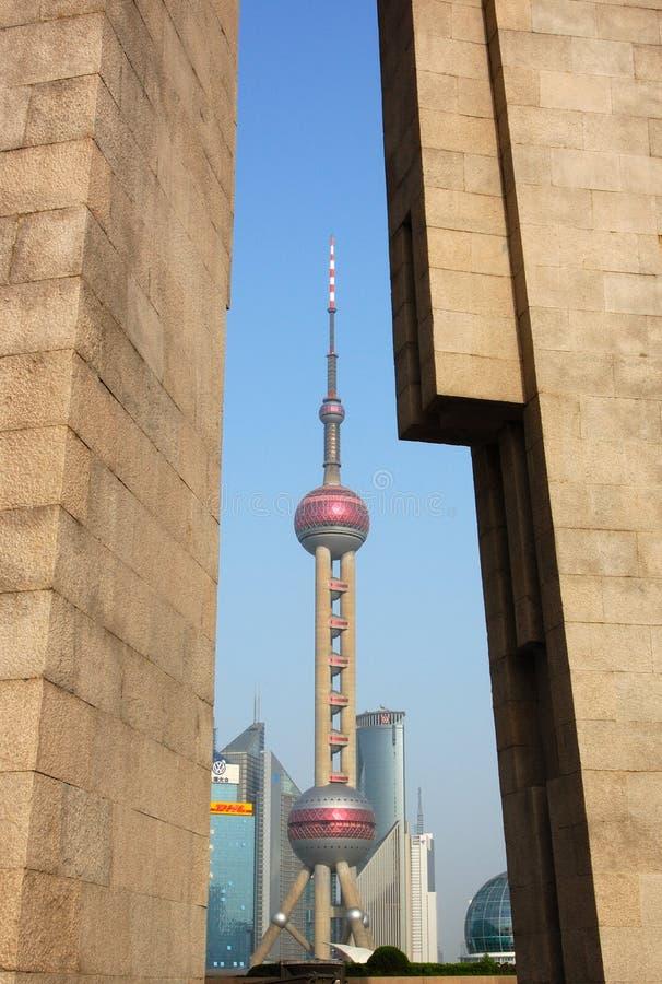 Oriental pearl through monument. Look oriental pearl through the monument of people's hero stock images
