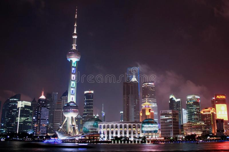 Oriental Pearl Radio and Television Tower protruding the Shanghai skyline on a warm summer night. royalty free stock photography