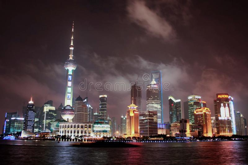 Oriental Pearl Radio and Television Tower protruding the Shanghai skyline on a warm summer night. Captured in this composition are the tall illuminated royalty free stock images
