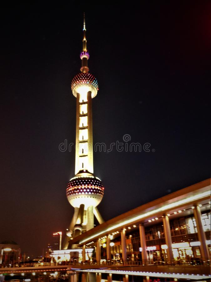 The Oriental Pearl Radio & Television Tower in Shanghai city, China. Night and bright colours. Landmark and beauty, altitude and elevation, power and stock photos