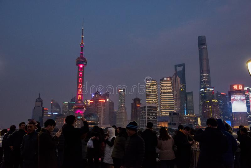 Crowds gather at Waitan to view the Oriental Pearl Tower. The Oriental Pearl Radio & Television Tower is a TV tower in Shanghai. Its location at the tip of stock images