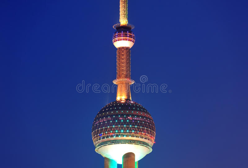 Oriental Pearl Tower. SHANGHAI, CHINA - JUNE 2: Oriental Pearl Tower over river on JUNE 2, 2012 in Shanghai, China. The tower was the tallest structure in China royalty free stock images