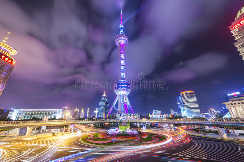 Oriental Pearl Tower. SHANGHAI, CHINA - JUNE 18, 2014: The landmark Oriental Pearl Tower at night in Lujiazui Financial District. The tower was the tallest stock photo