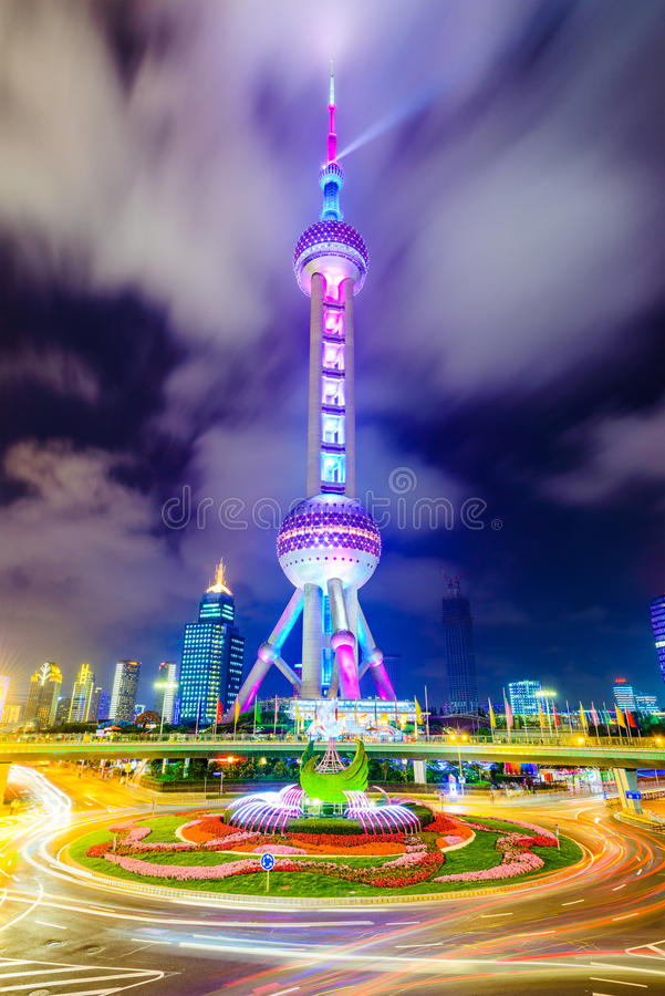 Oriental Pearl Tower of Shanghai. SHANGHAI, CHINA - JUNE 18, 2014: The landmark Oriental Pearl Tower at night in Lujiazui Financial District. The tower was the stock images
