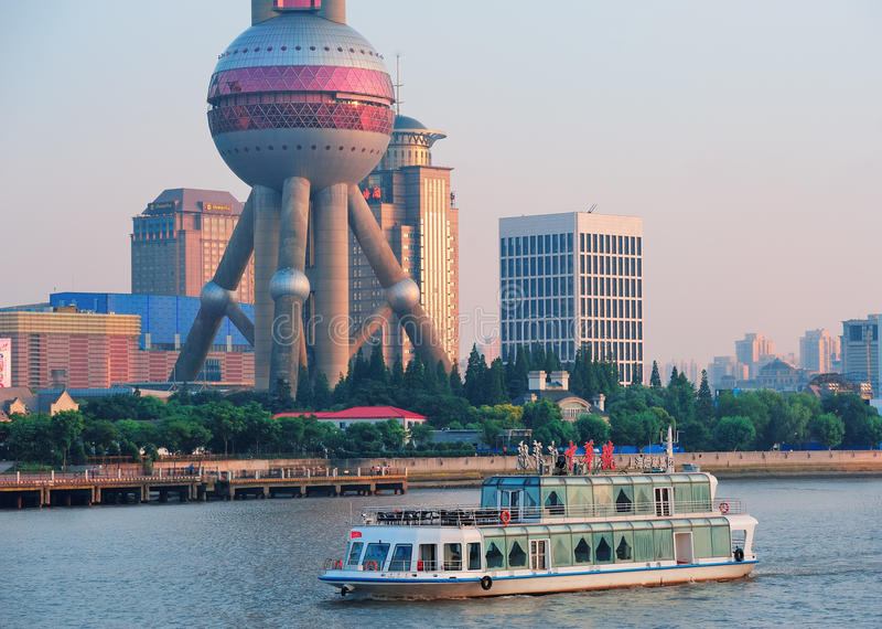 Oriental Pearl Tower. SHANGHAI, CHINA - JUNE 2: Oriental Pearl Tower over river on JUNE 2, 2012 in Shanghai, China. The tower was the tallest structure in China royalty free stock photos