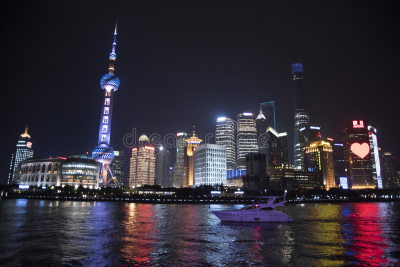 Oriental Pearl Tower at night, Shanghai. Oriental Pearl Tower and surrounding buildings seen across the Huangpu River at night royalty free stock photo