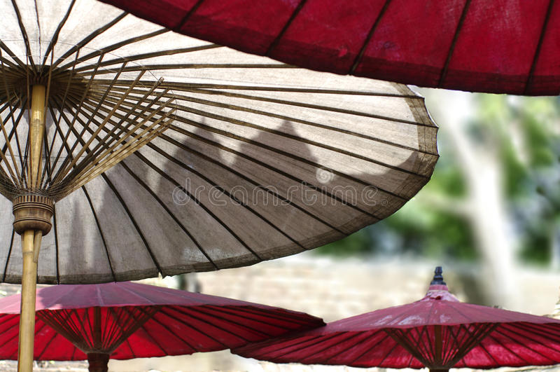 Oriental red umbrella, abstract background stock photography