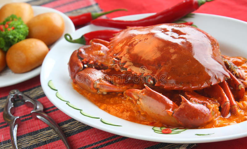 Oriental Spicy Crab. Whole spicy crab delicacy served with fried mantou (Chinese steamed buns royalty free stock images