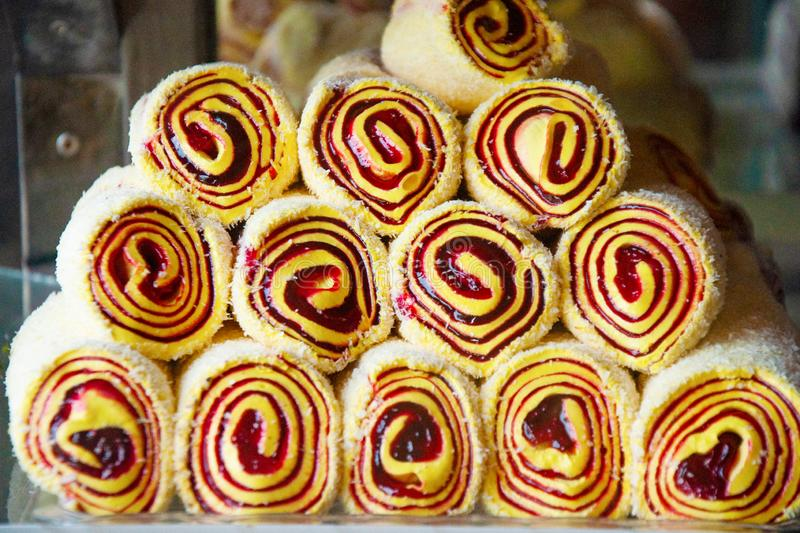 Oriental sweets on the counter of the store. Sweet rolls are folded with a pyramid. Organization of presentation on a store shelf. Oriental sweets on the counter stock photos
