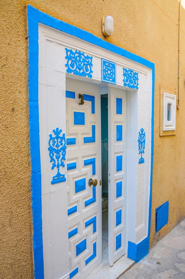 Oriental white blue door with ornament in Hammamet Tunisia.  royalty free stock photography