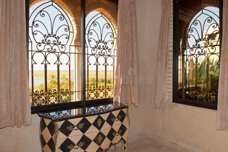 Oriental window with view to beautiful beach, Hotel La Sultana, Morocco stock photo