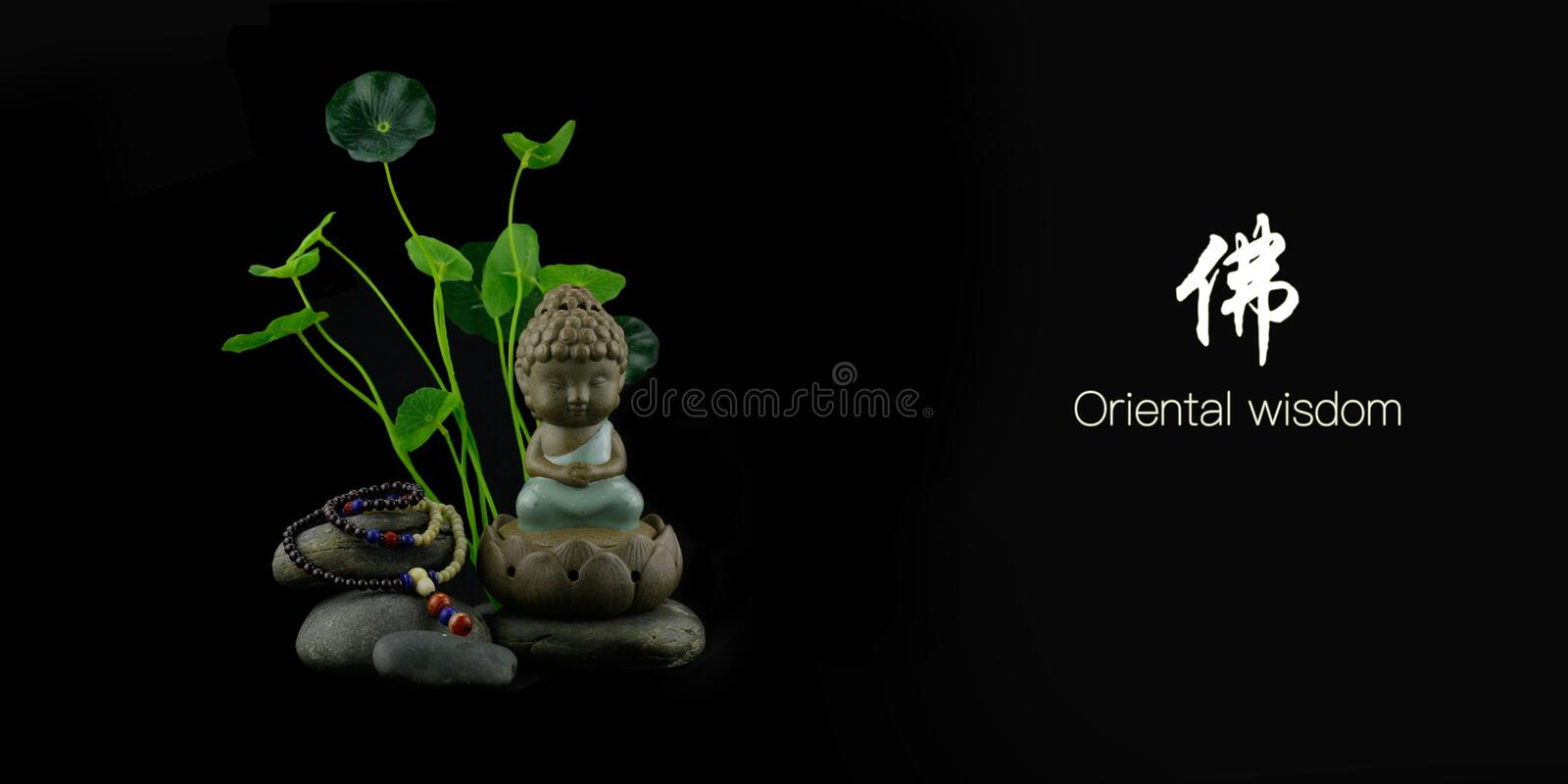 Oriental wisdom Buddha. Several elements, the Buddha and the bracelet stock images