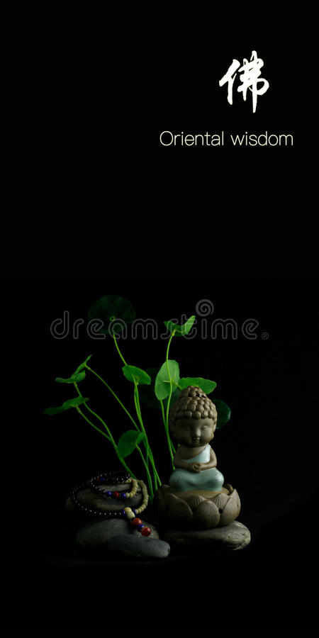 Oriental wisdom Buddha. Still life with Oriental Buddha Bracelet combination stock photography