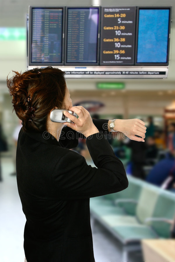 Oriental woman at airport stock photography