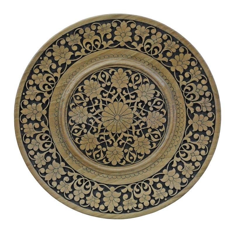 Orientalisch geschnitzte Ornamente auf Holzplatte lizenzfreie stockfotografie