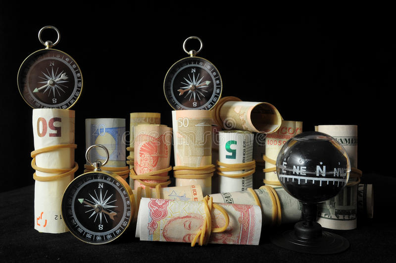 Orientation in Business. Compass and Money on a Black Background royalty free stock photography