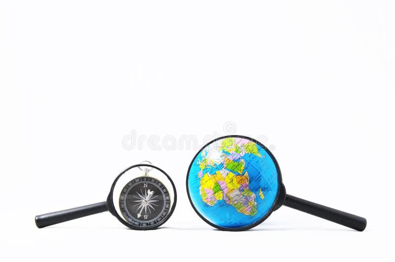 Orientation Concept. Earth,Magnify Glass and Compass on a White Background royalty free illustration