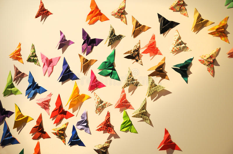 Origami. A swarm of colorful origami butterflies vector illustration