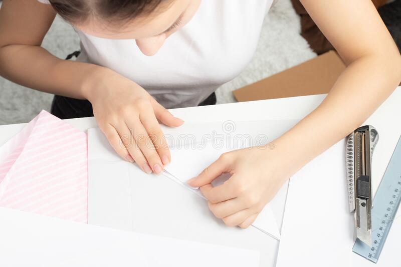 Origami is an ancient Chinese art of folding paper. Young woman doing a stick figure.  royalty free stock photo