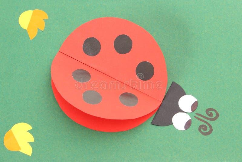 Origami biedronka forma przetwarzający papier fotografia stock