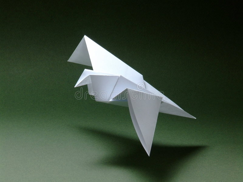 Origami Bird. A flying bird made by origami - the traditional Japanese art of paper folding