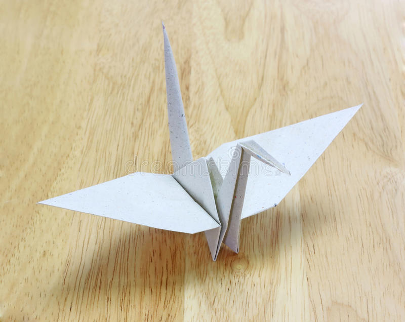 Download Origami Bird Made Of Recycle Paper On Wood Floor Stock Image - Image: 21051125