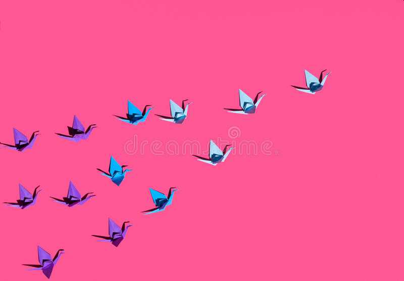 Origami birds on pink stock images