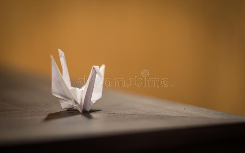 Origami of a birds using white paper stock photo