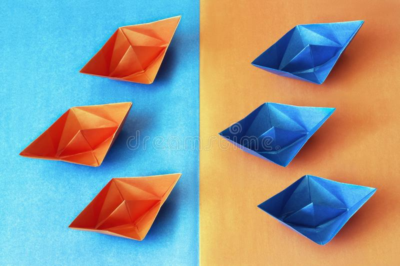 Origami. Blue and orange paper boats royalty free stock photo