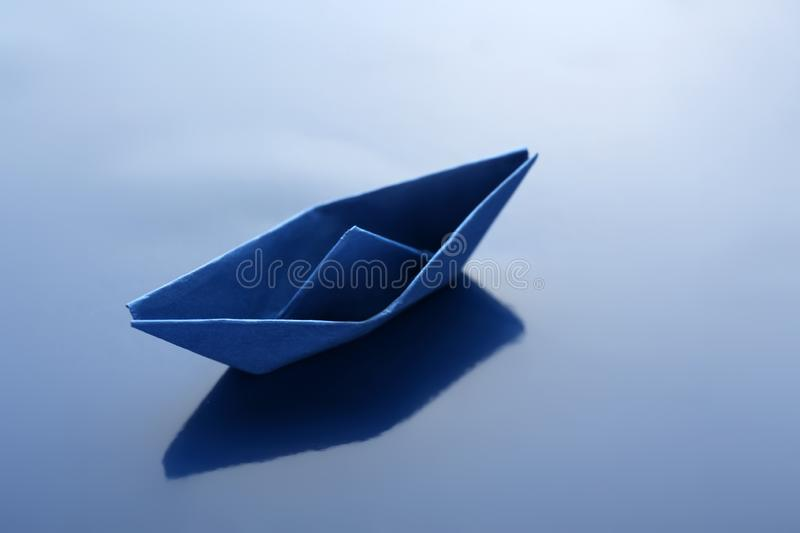 Origami boat on color surface royalty free stock photos