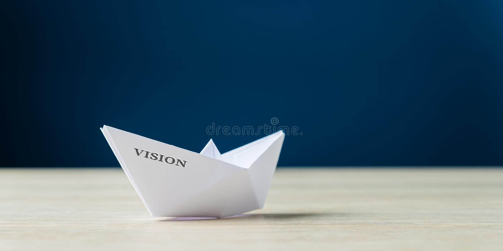 Origami boat with the word Vision on it royalty free stock images