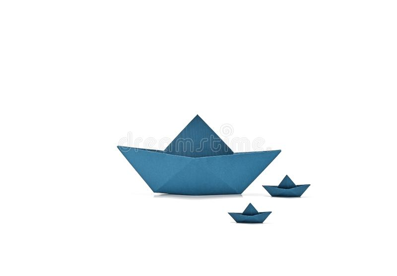Origami boats, floating boats, sailing ships, paper boats, three blue floating boats isolated on white background stock photo