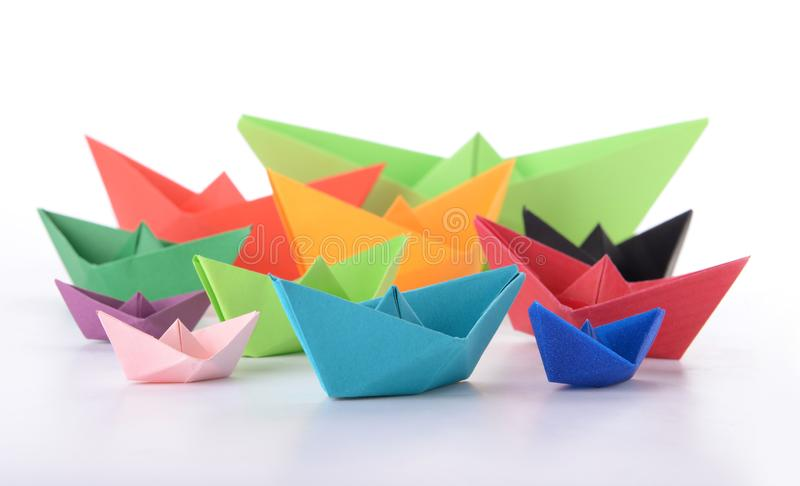Origami boats on white background stock photos