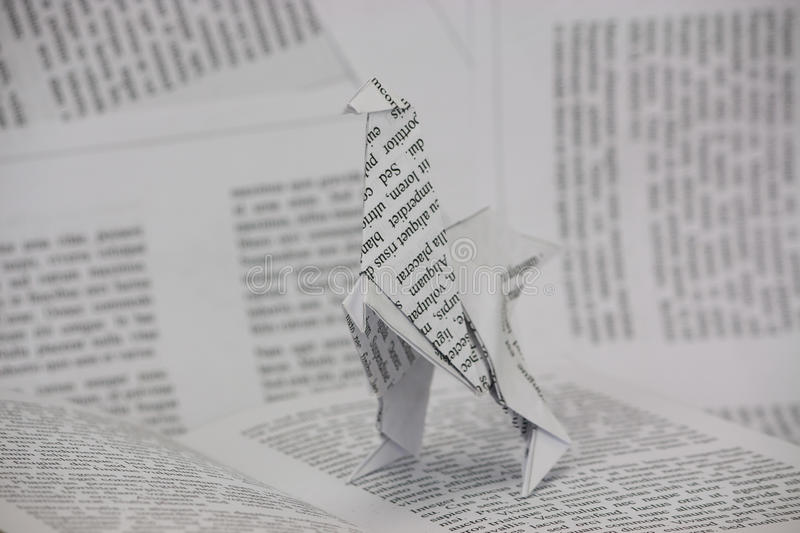 Download Origami Dinosaur Coming Out Of A Book Stock Image