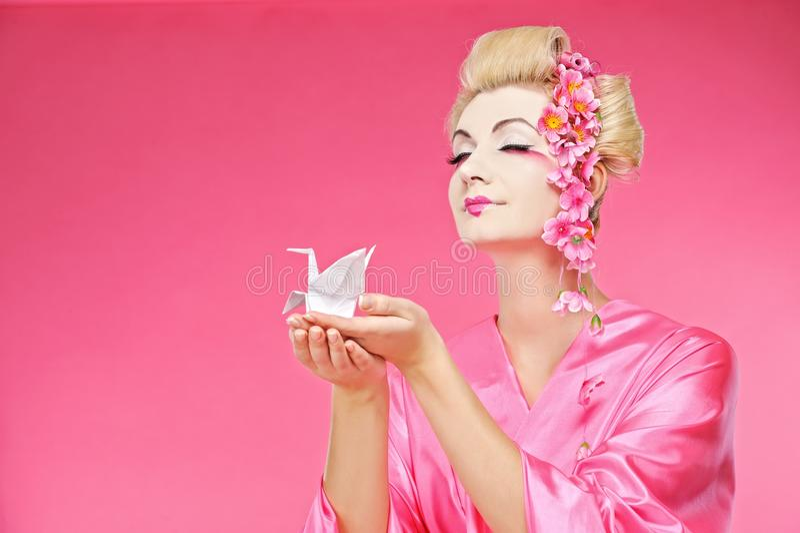 origami för fågelgeishaholding arkivfoton