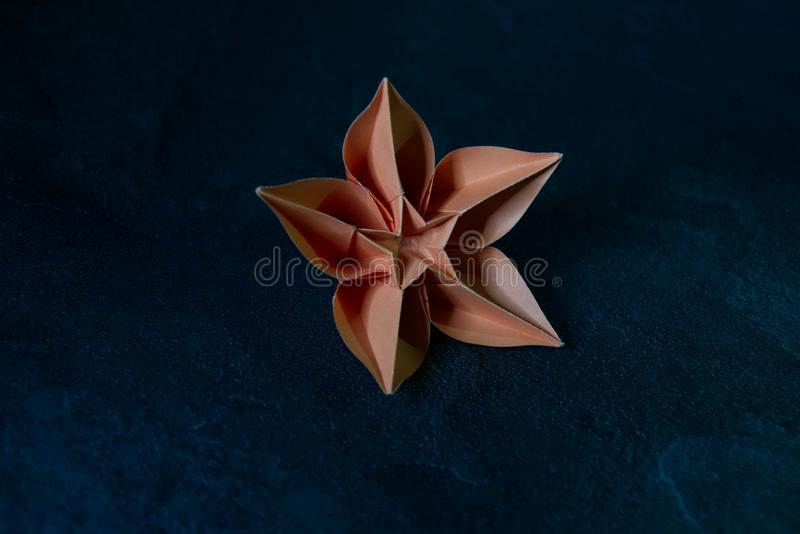 Origami Flower Blossom - Paper Art on Textured Background stock photos