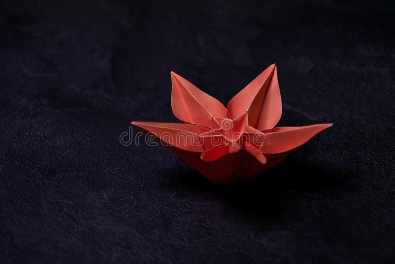Origami Flower Blossom - Paper Art on Textured Background stock photo