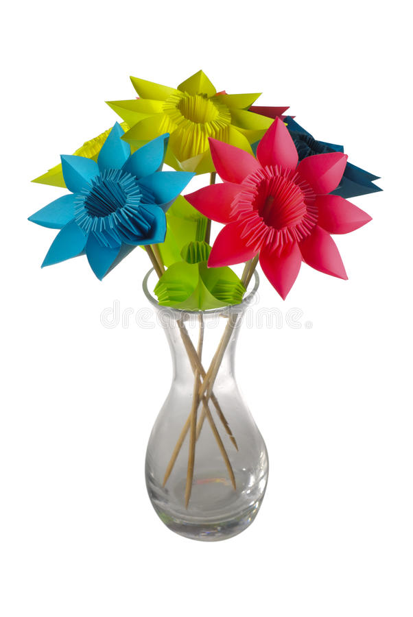 Origami flowers in glass vase stock photography