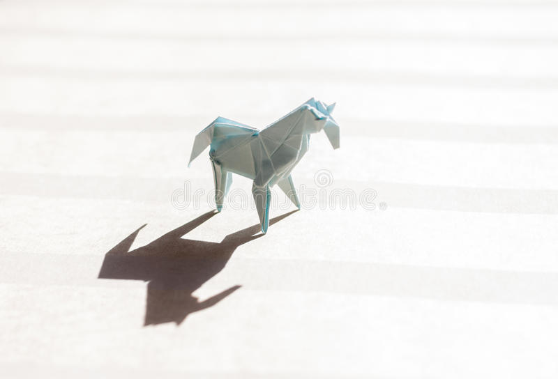 Origami horse on paper field royalty free stock images
