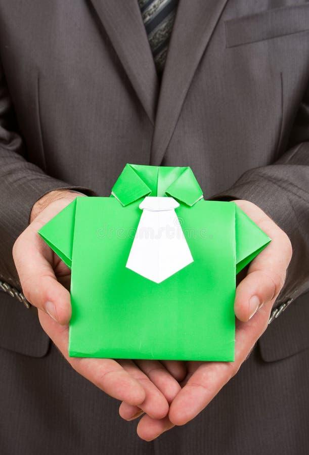 Origami Klage in den Händen lizenzfreies stockbild