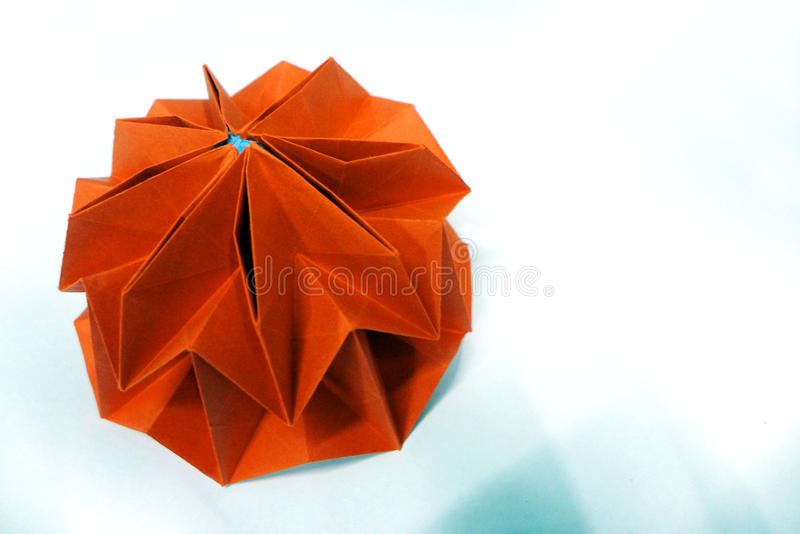 Origami mathematics - ball. Modular origami ball with 8-fold rotational symmetry. A photograph showing a beautiful origami ball constructed from folded paper royalty free stock images
