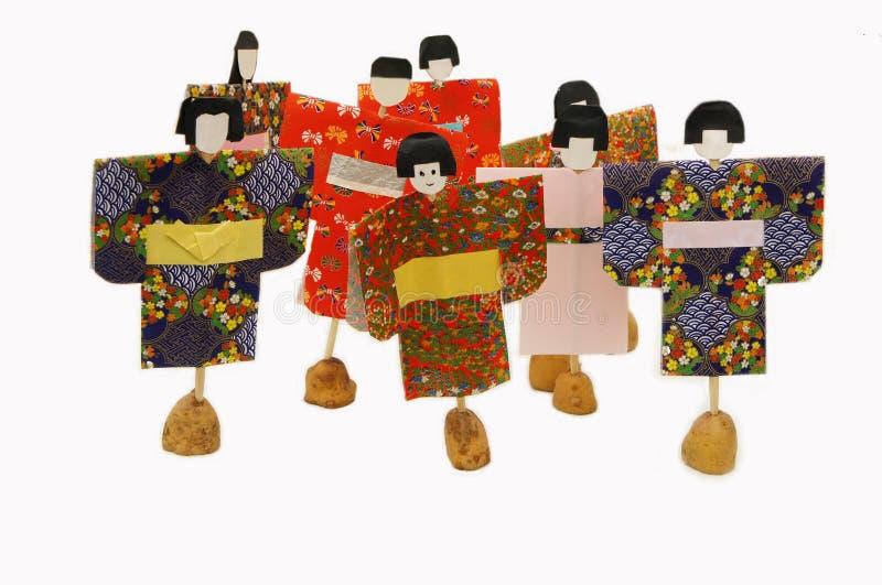 Origami op gekleurde handpapers royalty-vrije stock foto's