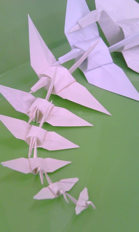 Origami op groen stock foto