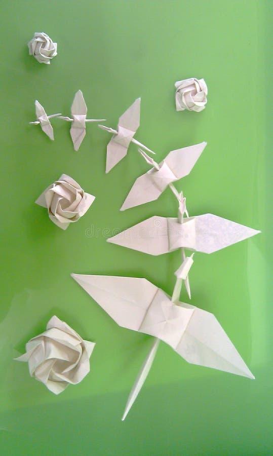 Origami op groen stock fotografie