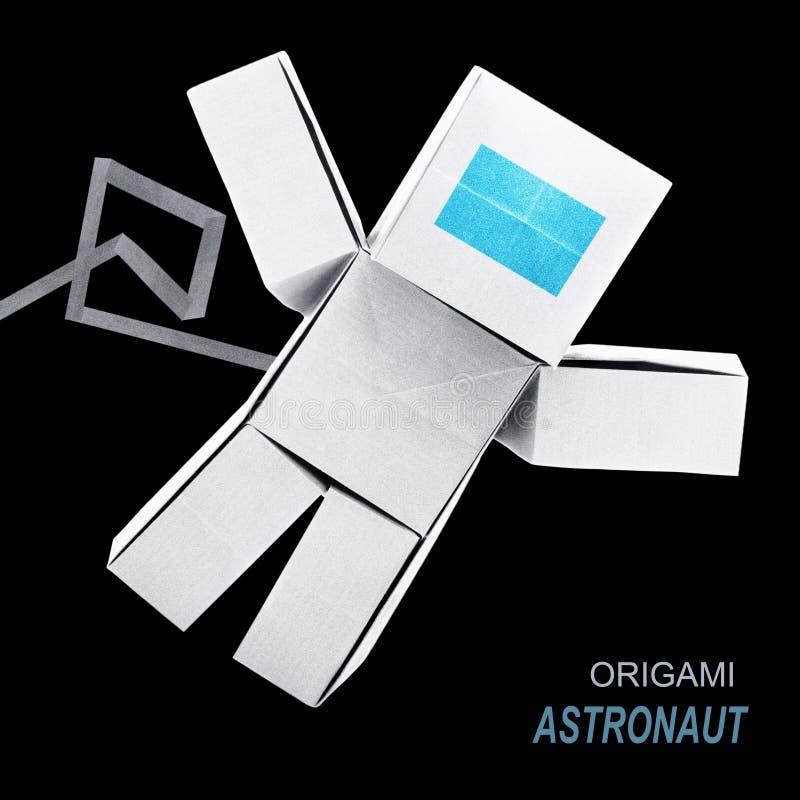 Origami paper astronaut stock photo