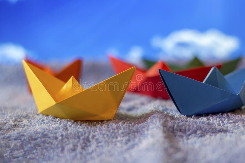 Origami paper boats royalty free stock photography