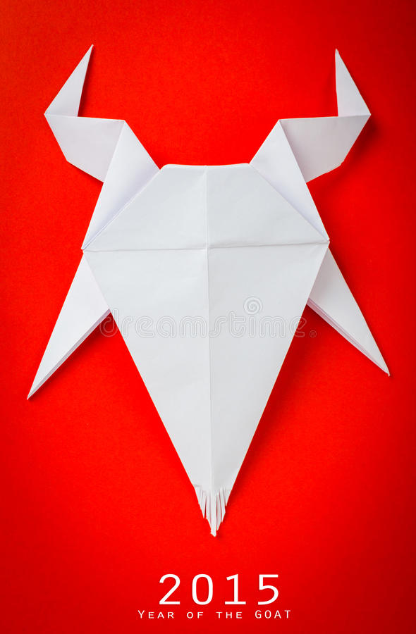 Origami paper goat on red background. royalty free stock photography