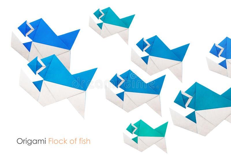Origami paper piranha flock. Origami paper piranha fish flock on a white background royalty free stock photos