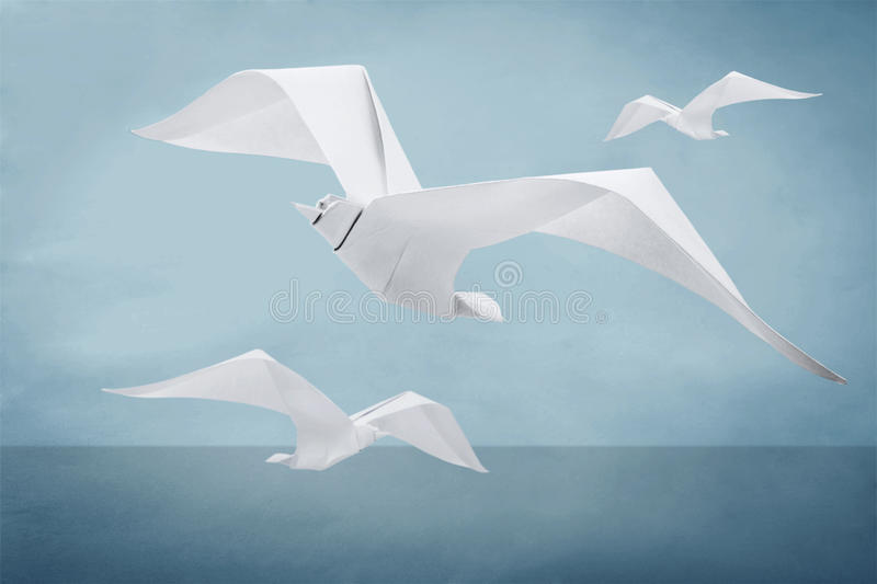 Origami paper seagull bird. Origami paper freedom seagull bird above a waves stock illustration