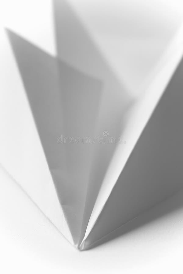 Origami - Papierflugzeug lizenzfreies stockbild